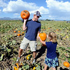 "Kerry Fritzler and daughter, Spencer, 7, compare pumpkins at the Rock Creek Pumpkin Farm on Sunday.<br /> For more photos and a video of pumpkin patches, go to  <a href=""http://www.dailycamera.com"">http://www.dailycamera.com</a><br /> Cliff Grassmick / October 2, 2011"