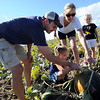 """Kerry Fritzler, left, his wife, Timi, and daughters, Spencer, 7, and Alexa, 5, pick out a green pumpkin for a witch carving.<br /> For more photos and a video of pumpkin patches, go to  <a href=""""http://www.dailycamera.com"""">http://www.dailycamera.com</a><br /> Cliff Grassmick / October 2, 2011"""