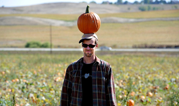 "Sandy Pryor poses with a pumpkin on his head for friends to photograph at Rock Creek Pumpkin Farm.<br /> For more photos and a video of pumpkin patches, go to  <a href=""http://www.dailycamera.com"">http://www.dailycamera.com</a><br /> Cliff Grassmick / October 2, 2011"