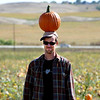 """Sandy Pryor poses with a pumpkin on his head for friends to photograph at Rock Creek Pumpkin Farm.<br /> For more photos and a video of pumpkin patches, go to  <a href=""""http://www.dailycamera.com"""">http://www.dailycamera.com</a><br /> Cliff Grassmick / October 2, 2011"""