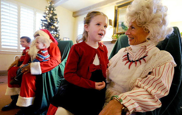 "Celeste Haverstick, 6,answers some Christmas questions for Mrs. Claus (Jeanie  DeMarinis) at Santa's House on Thursday. <br /> Santa's House features Santa and Mrs. Claus, musical performers, stories from Mother Goose, carnival games geared to the under 7 age group, and a craft/bake sale table for the entire family. Santa's House, a home decorated in a festive, traditional holiday style located at 890 11th Street in Boulder (Pi Beta Phi house), has been a Boulder tradition since 1972. This annual community event which takes place the first weekend in December is sponsored by the Boulder Area Alumnae Panhellenic.  Santa's House is open to the public from 10:00 AM - 4:00 PM December 1st and 2nd. Admission is $3 per person with proceeds donated to local children's charities.  For more information on Santa's House visit  <a href=""http://www.SantasHouseBoulder.org"">http://www.SantasHouseBoulder.org</a>. <br /> For more photos and a video, go to  <a href=""http://www.dailycamera.com"">http://www.dailycamera.com</a>.<br /> Cliff Grassmick  / November 29, 2012"