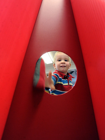 "Boyd Buie, 2, uses the direct approach to the bean bag toss at Santa's House on Thursday. Santa's House features Santa and Mrs. Claus, musical performers, stories from Mother Goose, carnival games geared to the under 7 age group, and a craft/bake sale table for the entire family. Santa's House, a home decorated in a festive, traditional holiday style located at 890 11th Street in Boulder (Pi Beta Phi house), has been a Boulder tradition since 1972. This annual community event which takes place the first weekend in December is sponsored by the Boulder Area Alumnae Panhellenic.  Santa's House is open to the public from 10:00 AM - 4:00 PM December 1st and 2nd. Admission is $3 per person with proceeds donated to local children's charities.  For more information on Santa's House visit  <a href=""http://www.SantasHouseBoulder.org"">http://www.SantasHouseBoulder.org</a>. <br /> For more photos and a video, go to  <a href=""http://www.dailycamera.com"">http://www.dailycamera.com</a>.<br /> Cliff Grassmick  / November 29, 2012"
