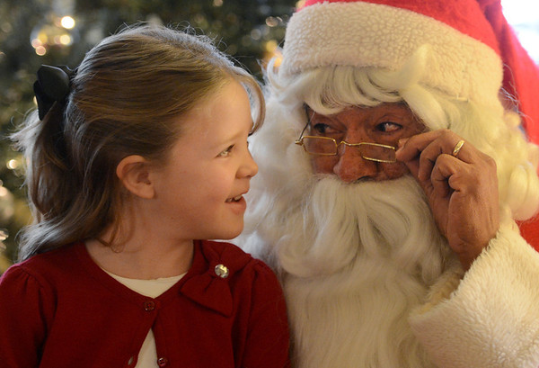"Celeste Haverstick, 6, has some fun with Santa Claus ( Rich Lopez)  at Santa's House on Thursday. <br />  Santa's House features Santa and Mrs. Claus, musical performers, stories from Mother Goose, carnival games geared to the under 7 age group, and a craft/bake sale table for the entire family. Santa's House, a home decorated in a festive, traditional holiday style located at 890 11th Street in Boulder (Pi Beta Phi house), has been a Boulder tradition since 1972. This annual community event which takes place the first weekend in December is sponsored by the Boulder Area Alumnae Panhellenic.  Santa's House is open to the public from 10:00 AM - 4:00 PM December 1st and 2nd. Admission is $3 per person with proceeds donated to local children's charities.  For more information on Santa's House visit  <a href=""http://www.SantasHouseBoulder.org"">http://www.SantasHouseBoulder.org</a>. <br /> For more photos and a video, go to  <a href=""http://www.dailycamera.com"">http://www.dailycamera.com</a>.<br /> Cliff Grassmick  / November 29, 2012"