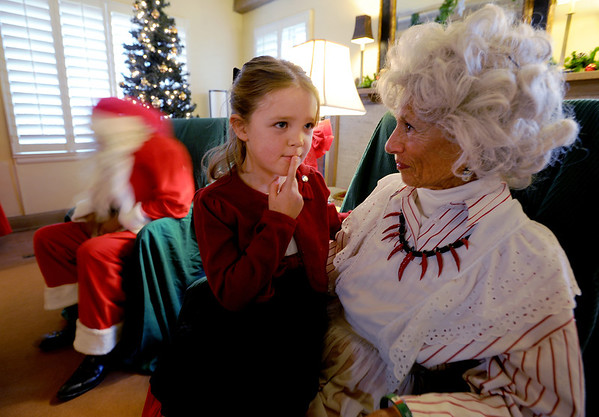 "Celeste Haverstick, 6, thinks about the answer she will give Mrs. Claus (Jeanie  DeMarinis) at Santa's House on Thursday.<br />  Santa's House features Santa and Mrs. Claus, musical performers, stories from Mother Goose, carnival games geared to the under 7 age group, and a craft/bake sale table for the entire family. Santa's House, a home decorated in a festive, traditional holiday style located at 890 11th Street in Boulder (Pi Beta Phi house), has been a Boulder tradition since 1972. This annual community event which takes place the first weekend in December is sponsored by the Boulder Area Alumnae Panhellenic.  Santa's House is open to the public from 10:00 AM - 4:00 PM December 1st and 2nd. Admission is $3 per person with proceeds donated to local children's charities.  For more information on Santa's House visit  <a href=""http://www.SantasHouseBoulder.org"">http://www.SantasHouseBoulder.org</a>. <br /> For more photos and a video, go to  <a href=""http://www.dailycamera.com"">http://www.dailycamera.com</a>.<br /> Cliff Grassmick  / November 29, 2012"
