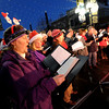 "Inger Barron, left, sings Christmas Carols with other members of the Boulder Chorale on Sunday.<br /> Santa Claus flipped  the switch that lit up the Pearl Street Mall and Boulder County Courthouse, as well as the star on Flagstaff Mountain.<br /> For a video and photo gallery  of the activities, go to  <a href=""http://www.dailycamera.com"">http://www.dailycamera.com</a>.<br /> Cliff Grassmick  / November 18, 2012"