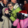 "Margo Yiegan, left, gets a hug from Wendy Jones, while Juliette Jones hides her face during the singing part of the Christmas program.<br /> Santa Claus flipped  the switch that lit up the Pearl Street Mall and Boulder County Courthouse, as well as the star on Flagstaff Mountain.<br /> For a video of the activities, go to  <a href=""http://www.dailycamera.com"">http://www.dailycamera.com</a>.<br /> Cliff Grassmick  / November 18, 2012"