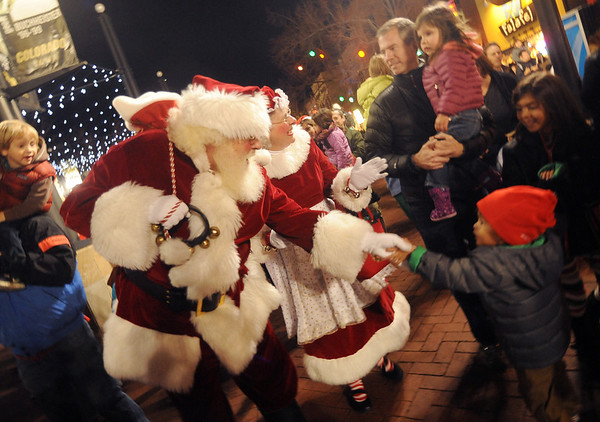 "Santa Claus and Mrs. Claus greet people along the Pearl Street Mall after the lighting ceremony.<br /> Santa Claus flipped  the switch that lit up the Pearl Street Mall and Boulder County Courthouse, as well as the star on Flagstaff Mountain.<br /> For a video of the activities, go to  <a href=""http://www.dailycamera.com"">http://www.dailycamera.com</a>.<br /> Cliff Grassmick  / November 18, 2012"