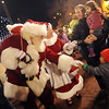 """Santa Claus and Mrs. Claus greet people along the Pearl Street Mall after the lighting ceremony.<br /> Santa Claus flipped  the switch that lit up the Pearl Street Mall and Boulder County Courthouse, as well as the star on Flagstaff Mountain.<br /> For a video of the activities, go to  <a href=""""http://www.dailycamera.com"""">http://www.dailycamera.com</a>.<br /> Cliff Grassmick  / November 18, 2012"""