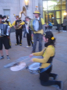 "The Expandable Brass Band playing in front of Dilboy Hall, 6-7pm Sat.      I should NOT try to take photos while playing!   Hopefully someone in the audience captured better photos of us. Hooray: someone shot a video of our arrival at this venue and 1st tune""Worksong"""