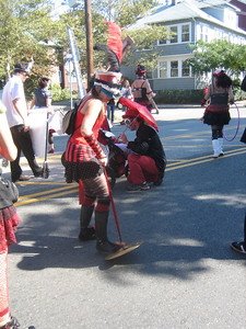 She played the cymbal on the pavement! Sometimes she dragged it along, or bounced it up and down like a yo-yo.