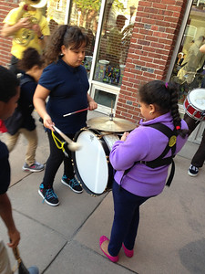 Young girls playing Jeff's drum