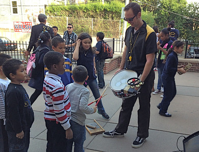 Kids lined up to play Jeremy's snare.