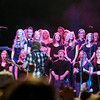 "The Anderson High School choir backs up Foreigner lead singer Kelly Hansen as they perform ""I Want to Know What Love Is"" Saturday night at Hoosier Park."