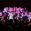 "The Anderson High School choir sing with Foreigner as they perform ""I Want to Know What Love Is"" Saturday night at Hoosier Park."