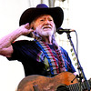 """Willie Nelson puts his hand up to his ear to listen to the audiences response as he sang """"Whiskey for my Men, Beer for my Horses"""" during his show at Hoosier Park Racing & Casino Friday night."""