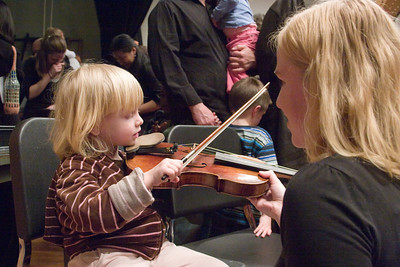 child with Susan Gutschow, violin --Hopkins Symphony Orchestra, March 2008