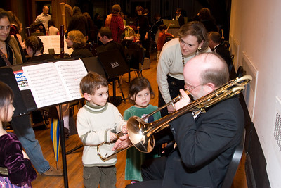 Charlie Phillips, trombone, with children-- Hopkins Symphony Orchestra, March 2008