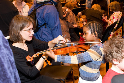 Laurie White, violin, with child -- Hopkins Symphony Orchestra, March 2008