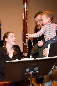 Katie FitzGibbon, bassoon, with child -- Hopkins Symphony Orchestra, March 2008