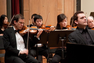 Andy White and Lay Kodama (with Sebastian Kwon, behind), violins -- Hopkins Symphony Orchestra, March 2011