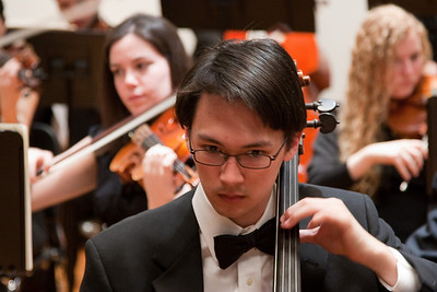 Adam Johnson, cello (with Allie Kornbluh and Heather Merchut, violins, behind) -- Hopkins Symphony Orchestra, March 2011