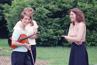 Laurie Buzak (White), unidentified, and Jennifer Emtage at HSO 1990 concert at Evergreen House, JHU