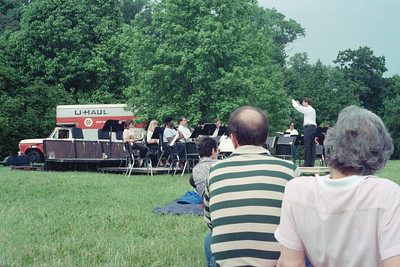 Eric Townell conducts the HSO during a performance on the grounds of Evergreen House, JHU, June 1990.