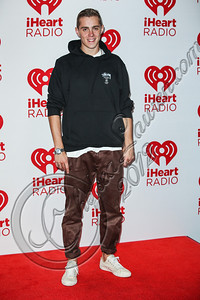 LAS VEGAS, NV - SEPTEMBER 22:  Rapper Sammy Adams arrives at iHeartRadio Music Festival press room at MGM Grand Garden Arena on September 22, 2012 in Las Vegas, Nevada.  (Photo by Chelsea Lauren/WireImage)