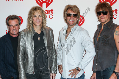 LAS VEGAS, NV - SEPTEMBER 21:  (L-R) Drummer Tico Torres, keyboardist David Bryan, musician Jon Bon Jovi and guitarist Richie Sambora of Bon Jovi arrive at iHeartRadio Music Festival press room at MGM Grand Garden Arena on September 21, 2012 in Las Vegas, Nevada.  (Photo by Chelsea Lauren/WireImage)