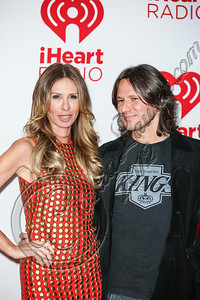 LAS VEGAS, NV - SEPTEMBER 22:  Author / television personality Carole Radziwill (L) and singer / songwriter Russ Irwin arrive at iHeartRadio Music Festival press room at MGM Grand Garden Arena on September 22, 2012 in Las Vegas, Nevada.  (Photo by Chelsea Lauren/WireImage)