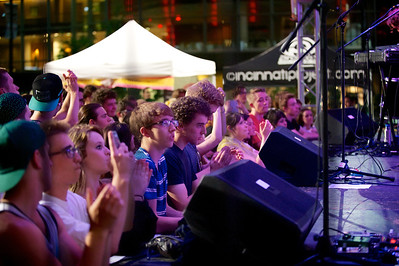 Fans watch The Pomegranates perform at Fountain Square for the kickoff of the MidPoint Indie Summer concert series