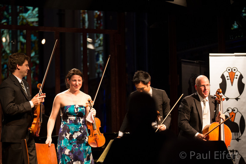 Violinists James Ehnes and Amy Schwartz Moretti, violist Richard O'Neill and cellist Robert deMaine receive a standing ovation after playing the Ravel Quartet in F at St George's Anglican church, in Montreal.