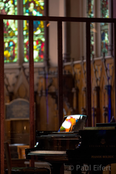 Light from the stained glass windows reflects off the Steinway grand piano before a chamber music concert at St. George's Anglican church in Montreal. Anglican church in Montreal.