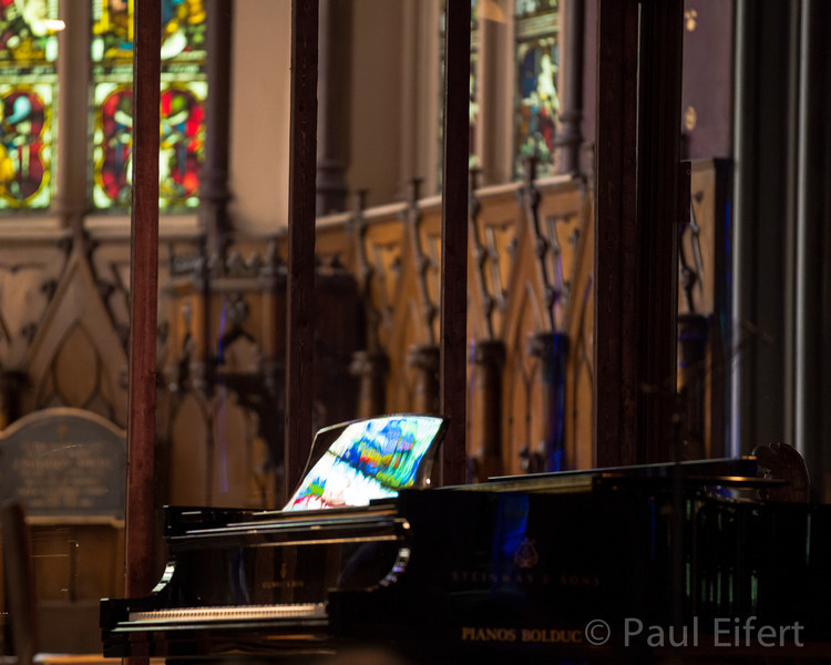 Light from the stained glass windows reflects off the Steinway grand piano before a chamber music concert at St. George's Anglican church in Montreal.
