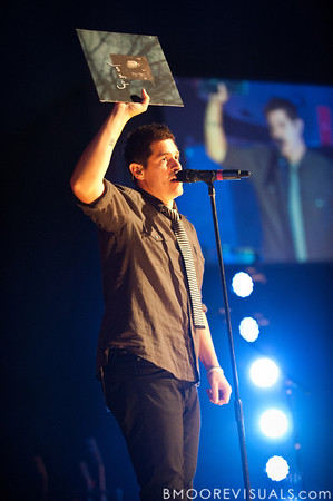 Dan Haseltine holds up a vinyl copy of Jars of Clay's multi-platinum self-titled debut album during the band's performance on October 23, 2010 at Countryside Christian Center in Clearwater, Florida. As 2010  marks the 15-year anniversary of the album's release, the band is performing many of the songs from this album throughout their current tour.