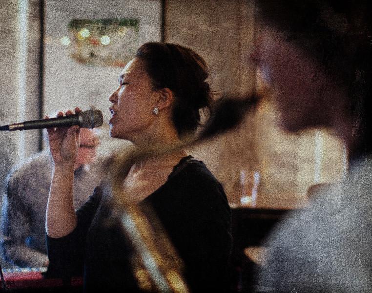Blurring the Sax.<br /> Birgitte Soojin: vocal and Jakob Dinesen: sax at P.H. Caffen, Copenhagen.<br /> Digital photo with texture layer.