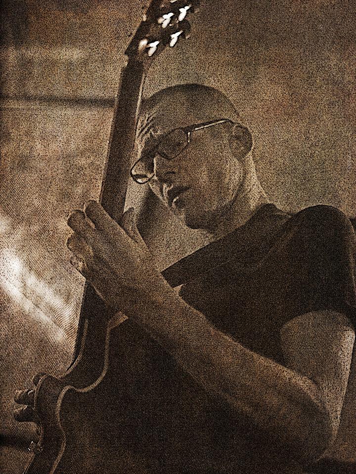"The Tao of Jazz Guitar.<br /> Guitarist Tao Højgaard at ""Cafe Svejk"", Copenhagen, Denmark.<br /> Black and white photo with texture."
