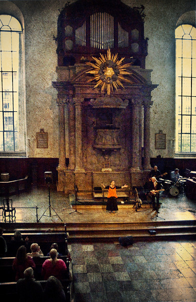 Join in.<br /> Vocalist Lillian Boutté in Christians Kirke, Copenhagen, Denmark.<br /> Photo with added texture.