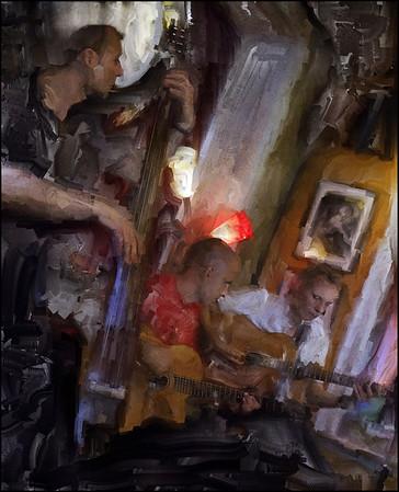 "Red Light Gypsies. Morten Ravn: bass - Robert Pilgaard: guitar -  Jens Fuglsang of <a href=""http://reve.dk/""target=""_blank"">Rêve Bohème</a> playing Django Reinhard at <a href=""http://www.bartofcafe.dk/""target=""_blank"">Bartof Cafe</a>, Copenhagen. Photo painted with digital sargent brush in Corel Painter."