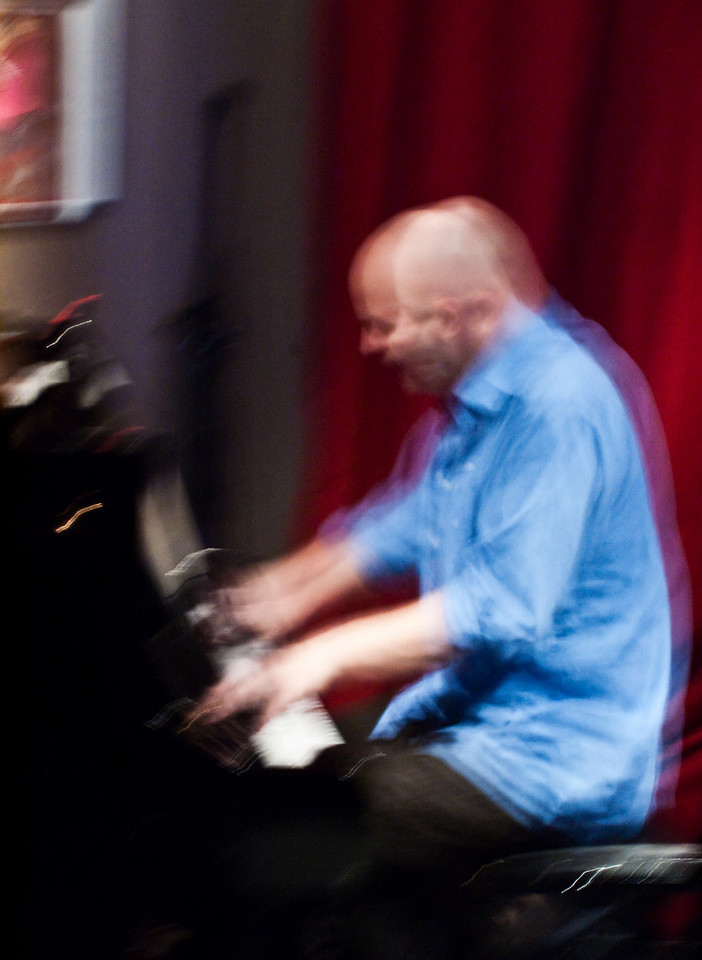 """Dancing with the Piano.<br /> Piano: Henrik Gunde at """"Jazz Cup"""", Copenhagen, Denmark<br /> Digital photo with slow shutterspeed."""