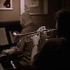 "Backing.<br /> Trumpet: Maj Berit Guassora and piano: Henrik Gunde at ""Jazz Cup"", Copenhagen Denmark.<br /> Sepia toned photo."