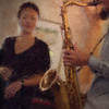 Let the Sax Sing.<br /> Birgitte Sojin: vocal and Jakob Dinesen: sax at PH Cafeen, Copenhagen.<br /> Photo painted with digital impressionist oil brush in Corel Painter + texture layers.