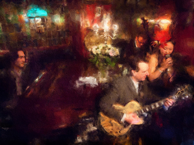 Jazz in the Living Room.<br /> Jakob Park: piano, Henrik Bay: guitar, Birgitte Soojin: vocal and Guffi Pallesen: bass at Cafe Intime, Copenhagen, Denmark<br /> Photo painted with digital impressionist chalk brush in Corel painter + texture layers.