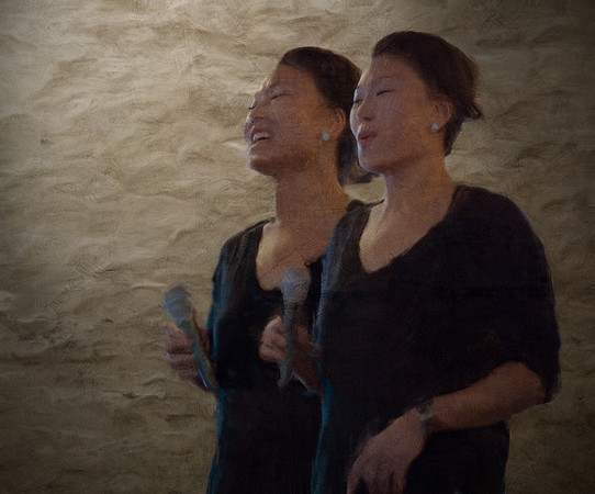 Twin Tone.<br /> Birgitte Soojin: vocal at P.H. Cafeen, Copenhagen.<br /> Two digital photos joined in,Photoshop, then painted with digital smeary oil brush in Corel Painter + texture layers.