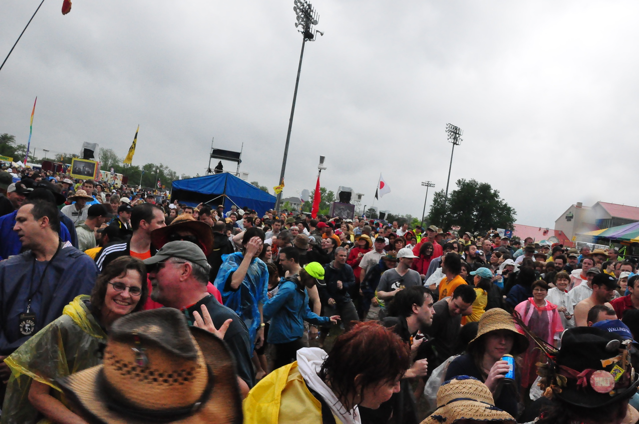No one lets a little rain (and thunder & lighting) ruin their party at Jazz Fest!