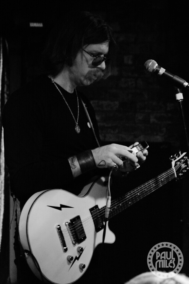 Jesse Hughes cueing up the next backing drum track on his iPod at Cherry bar in ACDC Lane, Melbourne.