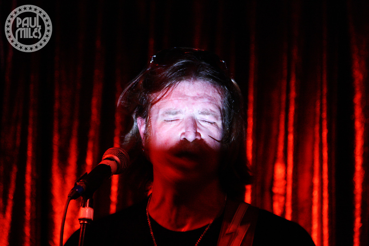 Eagles of Death Metal front man Jesse Hughes getting blinded by the light on stage at Cherry bar in Melbourne's AC/DC Lane.