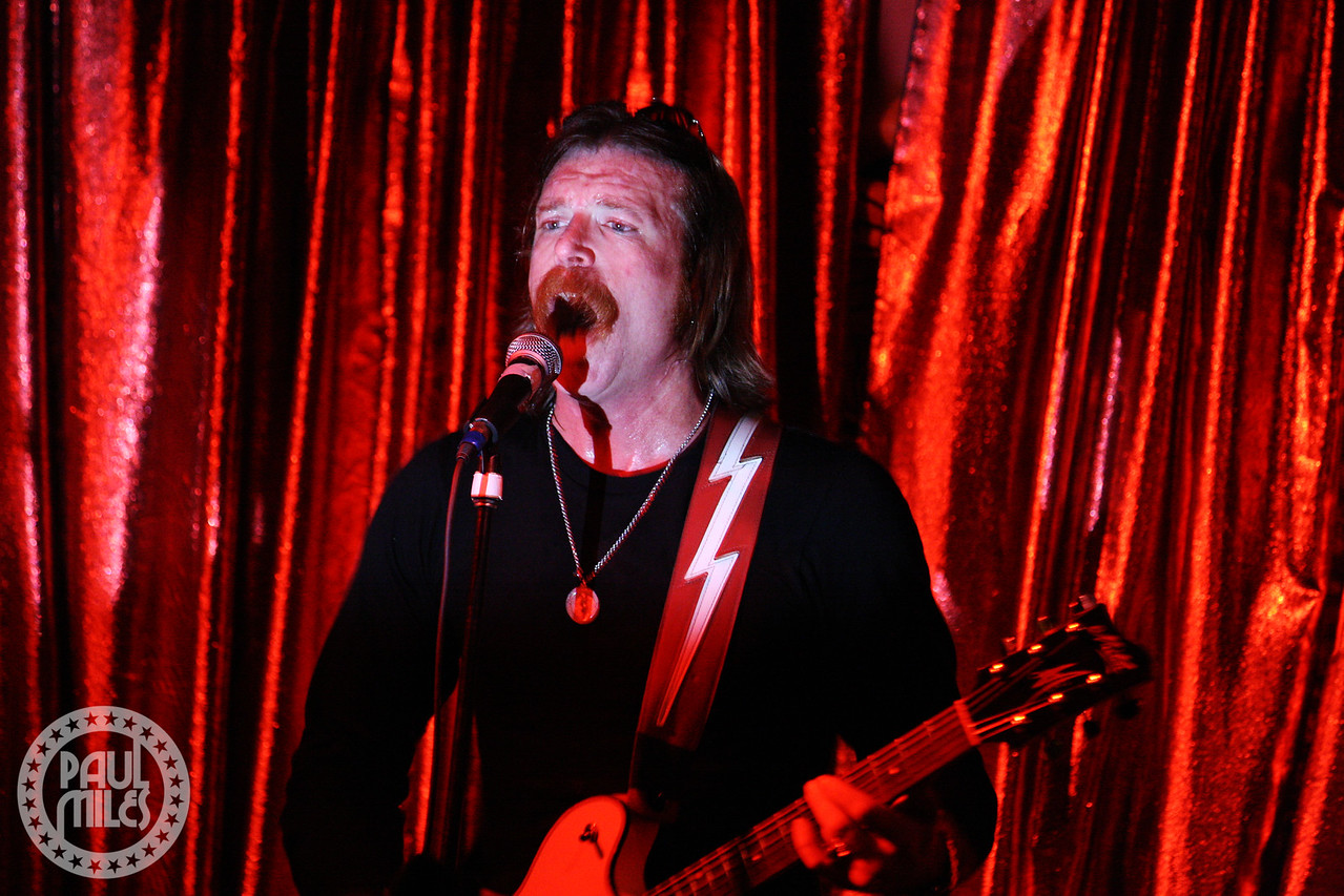 Jesse Hughes plays Cherry Cola during a Melbourne solo performance in February 2010.