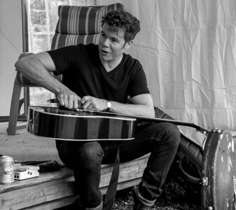 Josh Ritter changing his strings before his set at the 2014 Clearwater Festival.