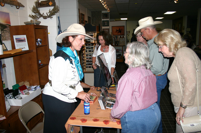 As you might expect, Juni Fisher's warm personality shines through.  Here, she visits with folks following her June 27, 2007 show in Spearfish, South Dakota.